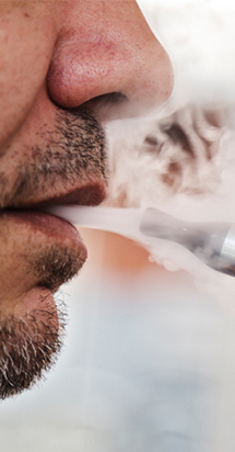 Male using a e-cigarette.