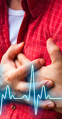 Man puts his both hands on his chest illustrating a heart attack.