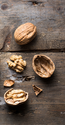 Diet changes and overall health: nuts on a cutting board.
