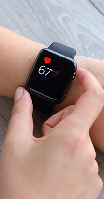 Woman using a health app on her smart watch.