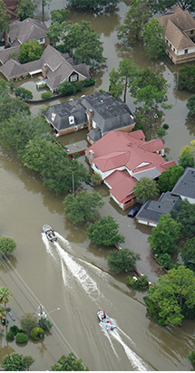 Aerial view of a flooded city with emergency and rescue boats.