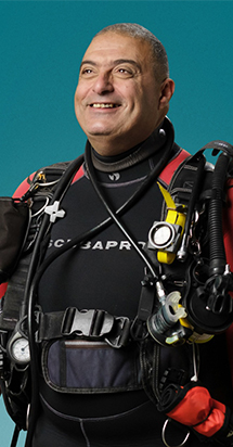 Middle-Aged deep sea diver excited to get ready for his adventurous swim.
