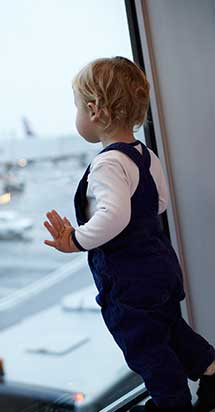 Baby looking at planes