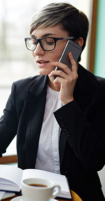businesswoman sincerely talking to her client in her mobile phone.